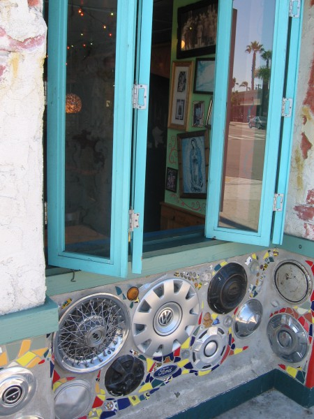 Hubcaps and tiles add flavor to a colorful local eatery.