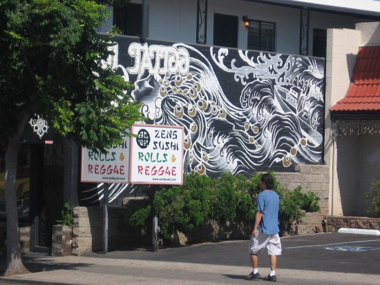 Another tattoo parlor embellished with urban art.