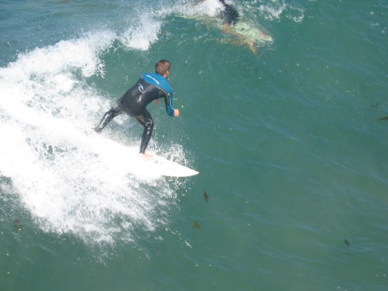 This surfer caught a good ride on a nice wave.