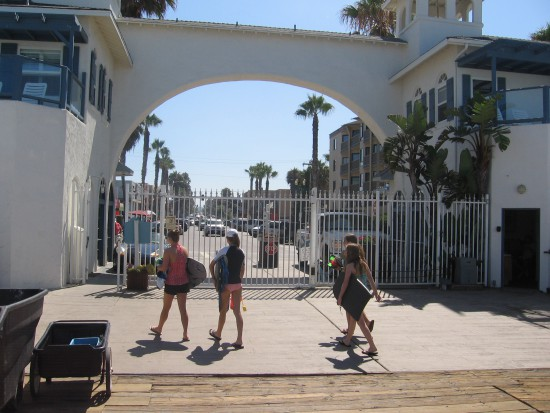 Leaving Crystal Pier, to walk down the Pacific Beach boardwalk.