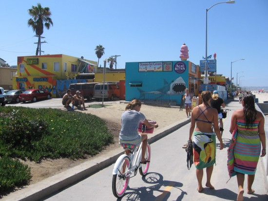 Folks head toward a shark and big ice cream cone!