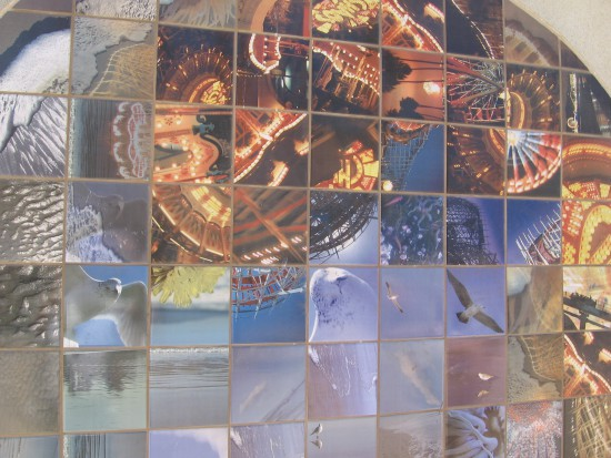 Photo mosaic on beach restroom shows bits of Belmont Park.