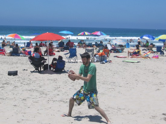 Playing football on the nearby sand at Mission Beach.