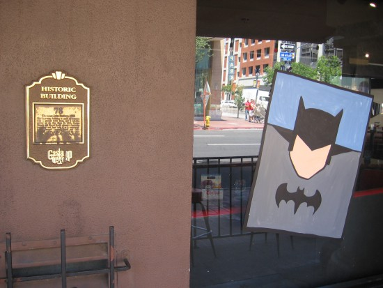 The Dark Knight watches from a historic Gaslamp building.
