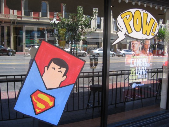 Gaslamp bar painted with Superman and POW word balloon.