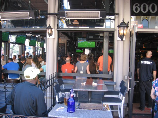 Bar patrons watch a soccer game.