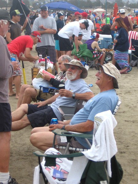 Some old guys just kicking back on the sand.