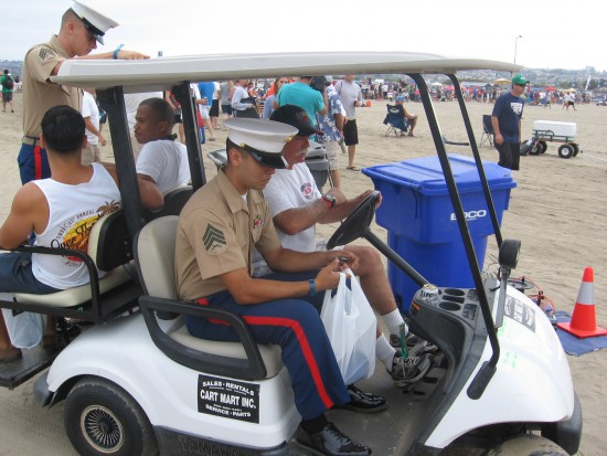 Marines from color guard pass on an OMBAC cart.