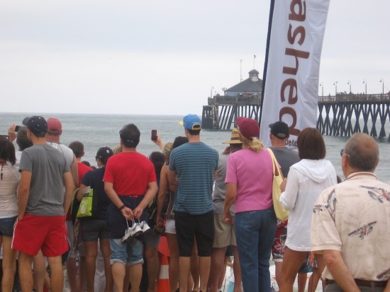 The crowd converges toward the water in disbelief.