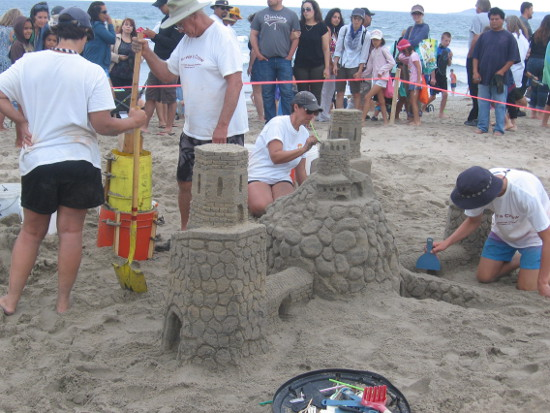 Teams north of Imperial Beach pier works on a detailed creations.