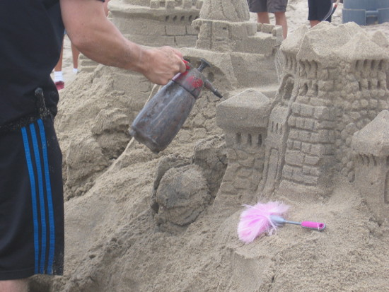 Sand creations are sprinkled with water to prevent disintegration.