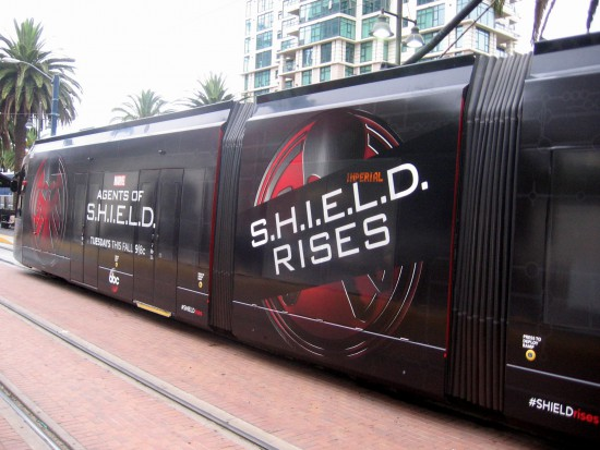 San Diego Comic-Con black trolley wrap reads S.H.I.E.L.D. RISES.