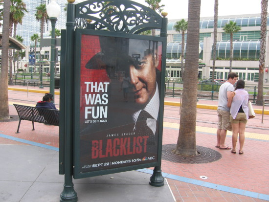Poster by trolley station promotes another season of Blacklist.