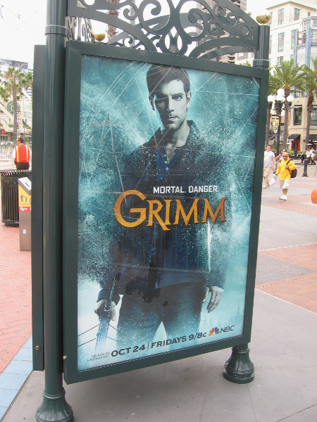 Grimm ad by the Gaslamp trolley station.
