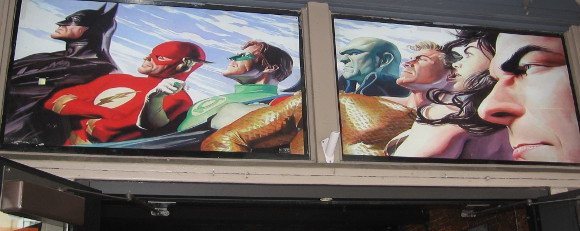Alex Ross cool Justice League graphic above a Gaslamp door.