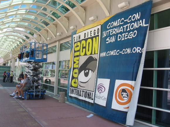 Workers take break while hanging 2014 San Diego Comic-Con banner!