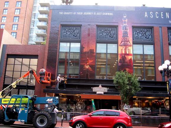 Ascension building wrap being applied early Tuesday morning.