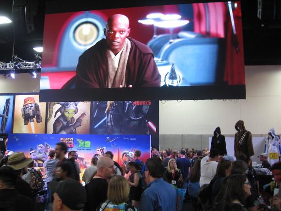 Mace Windu in a movie clip shown above huge Star Wars exhibit.
