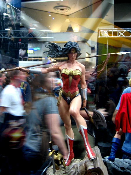 Wonder Woman in a glass case and passing fans.