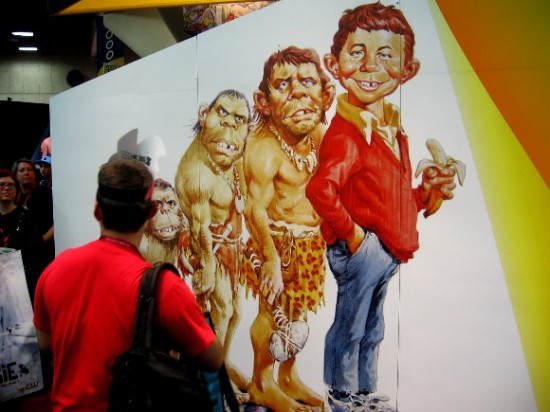 Alfred E. Neuman evolves from a caveman.