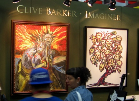 Horror paintings from Clive Barker's Imaginer art book on display.