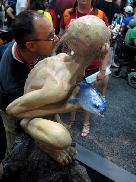 Gollum with a tasty fish poses with Tolkien fan.