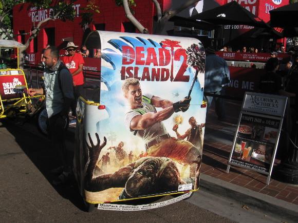 Dead Island 2 ad on back of enterprising pedicab.