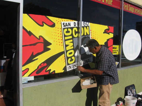 San Diego Comic-Con logo being painted on a taco shop window.
