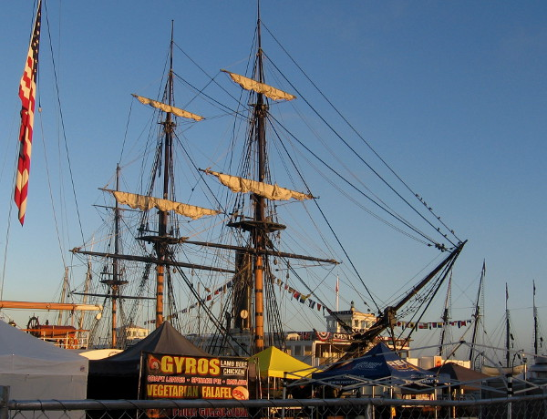 HMS Surprise of San Diego Maritime Museum and masts of visiting tall ships beyond.