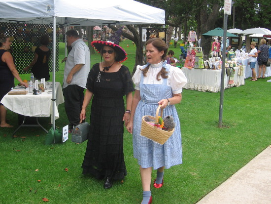 Dorothy and a Wicked Witch walk along checking out some art.