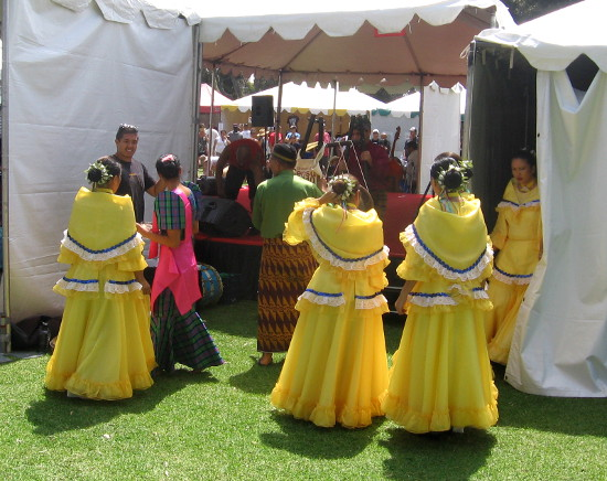 Folk dancers prepare to go on stage at today's cultural exhibition.