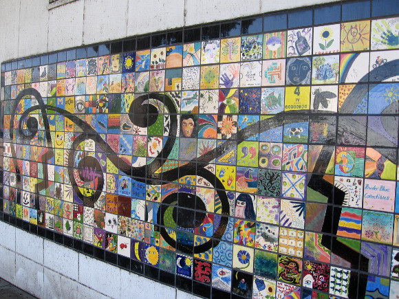 Hundreds of hand-painted tiles compose the colorful street mosaic.