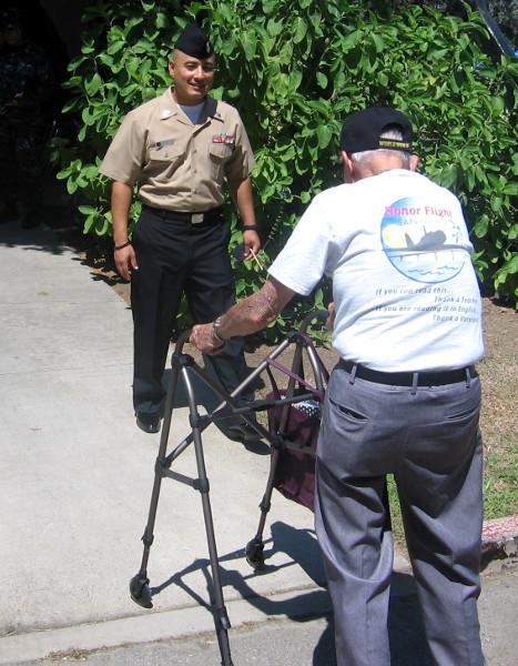 World War II veteran helped into museum side door.