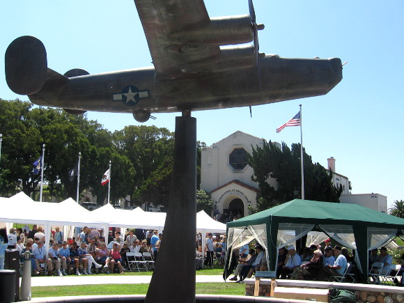 B-24 Liberator bomber from World War II rises above a nearby fountain.