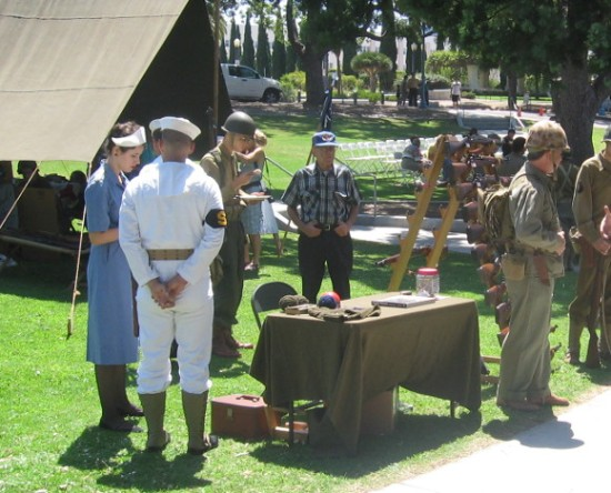 Many were wearing clothing and uniforms common during World War II.