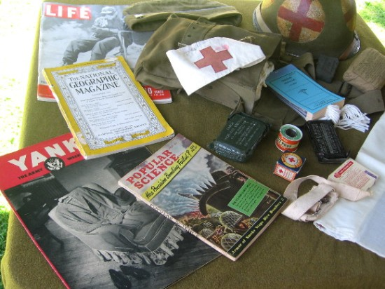 Scattered items inside a command tent include old magazines.