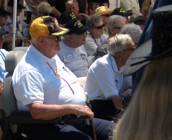 A generation of veterans listens as speakers honor their sacrifices for freedom.