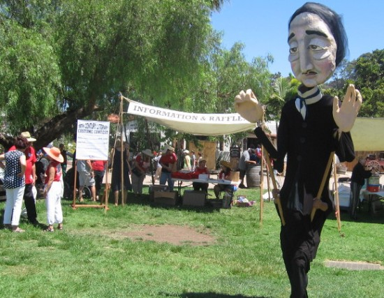 And here comes a towering puppet of American author Edgar Allan Poe!