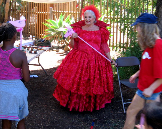 Carroll's Red Queen challenges all comers to flamingo croquet!