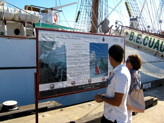 Visitors look at information sign near the Cuauhtémoc's gangplank.