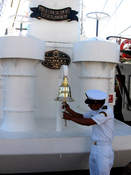 Mexican Navy officer checks the ship's bell.