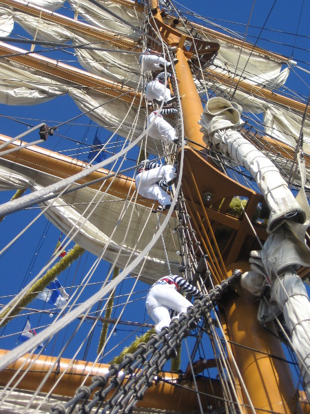 Higher they go up the enormous mast!