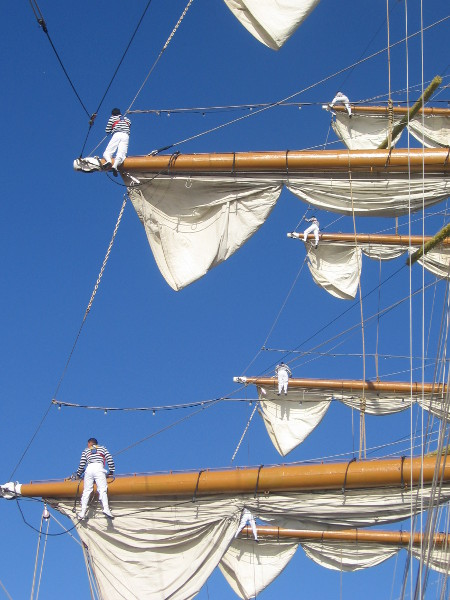 They demonstrate a bit of work with the sails.