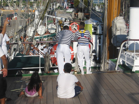 Guests and sailors watch the proceedings with interest.