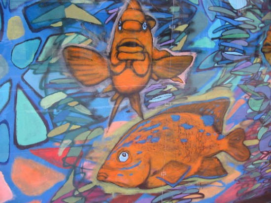 A colorful underwater scene can be glimpsed by passing motorists.