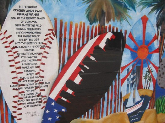 Various surfboards -- one contains an ode to baseball's World Series.