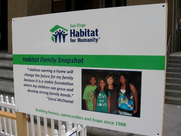 Sign explains how home ownership is beneficial for families.