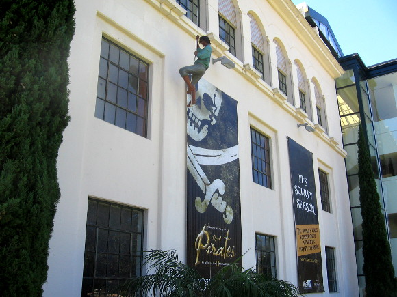 A daring pirate dangles beside the San Diego Natural History Museum.