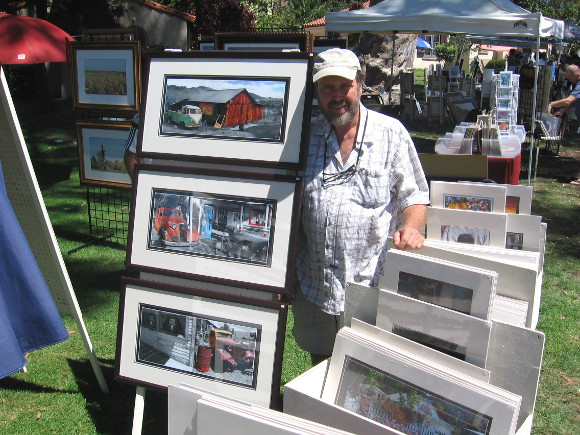 Photographer Dallas displays his fine work near the International Cottages.