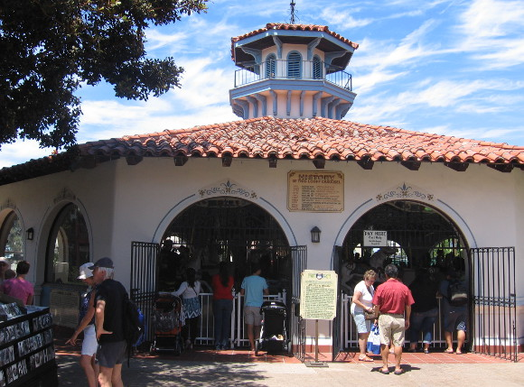 People enjoy a perfect day near the Seaport Village carousel.